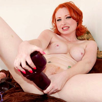 vixen stuffs a big toy into her redhead pussy